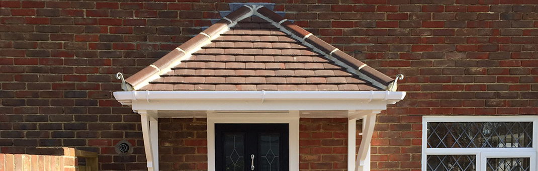 Timber door canopy with tiled roof