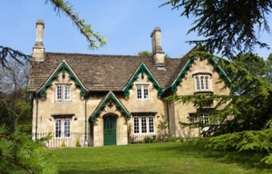 stone cottage in Somerset, England with ornate green barge boards