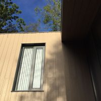 Concrete cladding with matching aluminium trim