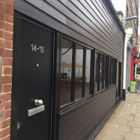 Black James Hardie cladding installation in London