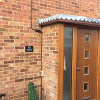 Door canopy replacement in Epping
