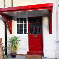 Red door canopy in Muswell Hill