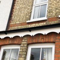 White scalloped fascia boards