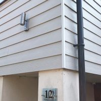 Modern grey cladding with new guttering