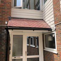Door canopy installation in Enfield