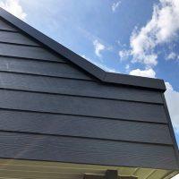 Grey timber effect weatherproof cladding