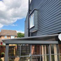 Grey weatherproof cladding installation
